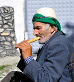 Old man plays flute Royalty Free Stock Photo