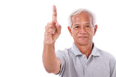 Old man pointing 1 finger up, no.1 gesture Royalty Free Stock Photos