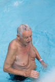 Old man in the pool Royalty Free Stock Photo