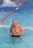 Old man in the pool Stock Images