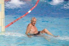 Old man in the pool Stock Photos