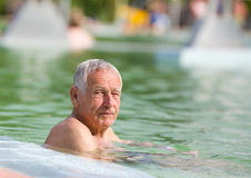Old man in pool Royalty Free Stock Photos