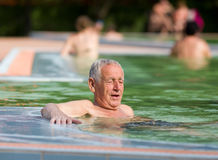 Old man in the pool Stock Image