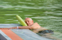 Old man in the pool Royalty Free Stock Images