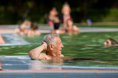 Old man in the pool Royalty Free Stock Photos