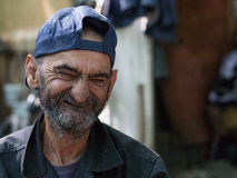 Old man portrait. Old funny face homeless man with big smile Stock Photos