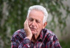 Old man portrait in garden stock photos