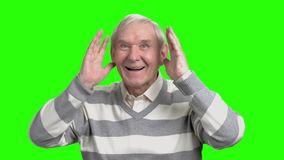 Old man portrait playing with kids. Grandpa put hands up and fooling around, hromakey background stock video