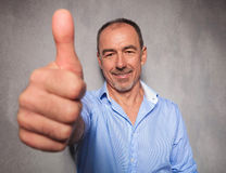 Old man posing in studio background showing the ok sign Royalty Free Stock Photos