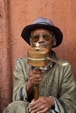 The old man with the prayer wheel Royalty Free Stock Photo