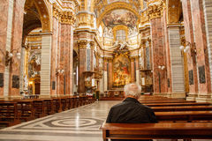 Old Man Praying in a Catholic Church in Rome royalty free stock photography