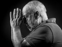 Old man praying Royalty Free Stock Photography