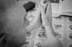 Old man praying Royalty Free Stock Images