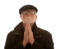 Old man praying Royalty Free Stock Photos
