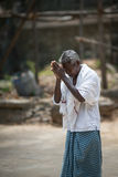 The old man is praying in a temple Stock Images