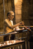 The old man is praying in a temple Stock Photo