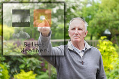 Old man pressing touch screen Royalty Free Stock Image