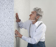 Old man put his hand on the wall Royalty Free Stock Photo