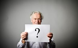 Old man in white and question mark. Royalty Free Stock Images