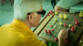 Old man is racing chess. Stock Images