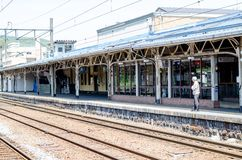 The old man and railway station in rural area. Royalty Free Stock Photography