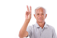 Old man raising 2 fingers, victory gesture Stock Images