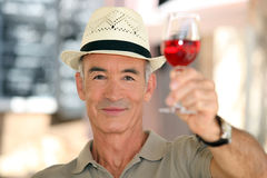Old man raising a glass Royalty Free Stock Image