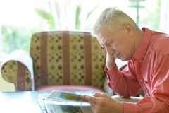 Old man reading Stock Photo