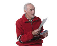 Old man reading a letter Stock Photo