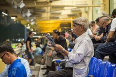 Old man reading newspaper at the Happy Valley Racecourse Stock Photography