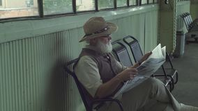 Old Man Reading A Newspaper stock footage