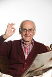 Old man reading newspapper Stock Photo