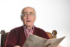 Old man reading newspapper Stock Photography