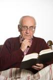 Old man reading royalty free stock image