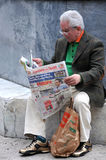 Old Man Reads Newspaper Stock Photo
