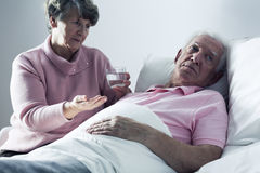 Old man rejecting medicines Royalty Free Stock Image