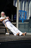 Old man relaxing in the harbour of Barcelona Stock Images
