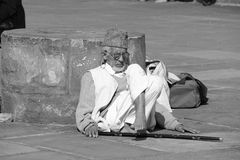 An old man relaxing at Jama Masjid Campus Stock Image