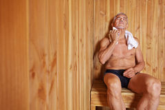 Old man relaxing in sauna Stock Images