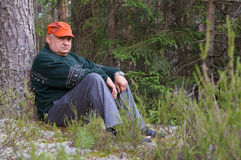 Old man resting in a forest Royalty Free Stock Images