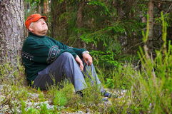 Old man resting in a forest Royalty Free Stock Photos