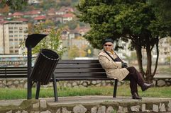Free Old Man Resting On A Bench Royalty Free Stock Images - 108321049
