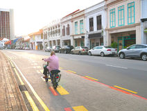 Old Man Riding a Bicycle Alone on The Street Singapore. Old man riding a bicycle alone on the empty street Singapore Stock Photography