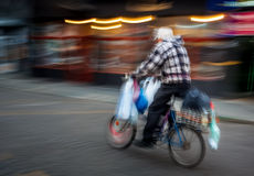 Old man riding a bicycle Royalty Free Stock Photos