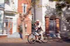 Old Man Riding Bike Stock Photography