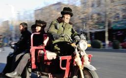 Old man riding motor bilk in Xin Jiang Street Stock Image