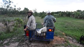 Old man riding motorcycle and daughter sit at cart go back home stock footage