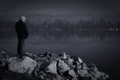 Old man by the river Royalty Free Stock Images