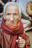 Old man with rosary in Bihar stock photography