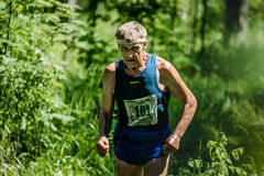 Old man run Stock Image